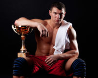 Picture of sportsman holding cup royalty free stock photo