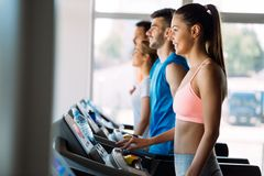 Picture of people running on treadmill in gym royalty free stock photo