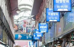 Rows of signboards in a local market. stock photos