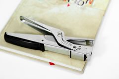 Picture of stapler on the closed diary. Isolated on the white background stock images