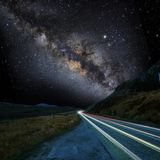 Milky way and the road royalty free stock image