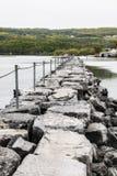 Stone jetty on Seneca Lake New York. A picture of a stone jetty on Seneca Lake New York stock images