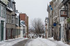 Street of the Old Town of Quebec City covered in snow. The Vieux Quebec is one of the oldest districts of North America. Picture of a street in the old town of stock photos