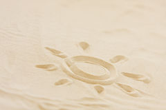 Picture of sun drawn into beach sand Royalty Free Stock Images