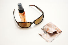 Sunglasses with cleaner Stock Photography