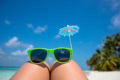 Picture of sunglasses on the tropical beach, vacation. Traveler Royalty Free Stock Image