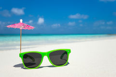 Picture of sunglasses on the tropical beach, vacation. Traveler Royalty Free Stock Images
