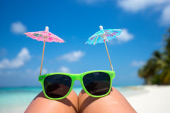 Picture of sunglasses on the tropical beach, vacation. Stock Photo