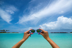 Picture of sunglasses on the tropical beach, vacation. Traveller Stock Photos