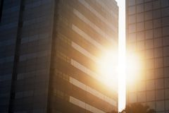 Sunlight between crevice of two high buildings. Picture of sunlight shining through the crevice of two high buildings. Shot at sunset time Royalty Free Stock Images