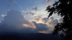 Sunset on cloudy sky. Picture of sunset on cloudy sky stock photos