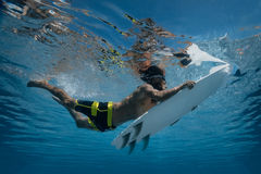 Picture of Surfing a Wave.Under Water Picture. Stock Photography