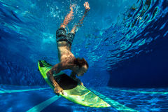 Picture of Surfing a Wave.Under Water Picture. Stock Images