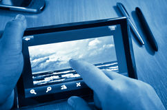 Picture on tablet-pc blue toned Royalty Free Stock Image