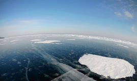 Picture taken by the action camera. Fish-eye lens. Panorama of the frozen ice of Lake Baikal Royalty Free Stock Image