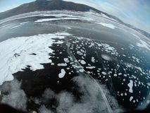 Picture taken by the action camera. Fish-eye lens. Panorama of the frozen ice of Lake Baikal Royalty Free Stock Images