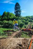 Downhill bike competition road gap jump. Picture taken at Bunloc Mountains in Carpathian mountains of Transylvania, Romania. First national downhill mountain Stock Photo