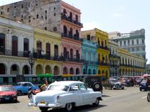 View of colored houses in the center of Havana with an oldtimer car, Cuba stock photo