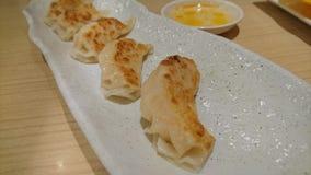 A plate of 4 shrimp dumplings stock photo