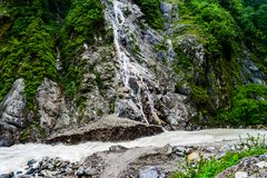 Waterfall In North Sikkim. Picture Taken In North Sikkim On The Way To Gurudongmar Where A Waterfall Meets With A River stock image