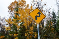 Move to right yellow road sign for a one lane road stock images