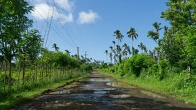 Typical bumpy road leading across Samoan island. Picture taken during road trip around Savaii, one of couple Samoan islands royalty free stock photography