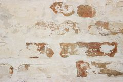 Painted white paint old brickwork. Paint peeling off over time stock photography