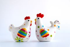 Loving easter chicken with and hen in porcelain on white background stock image