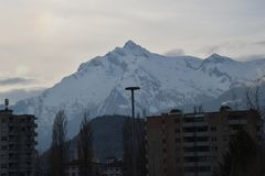 Snow mountain is everywhere in Switzerland. This picture is taken from the window of my room. The snow mountain is everywhere in Switzerland stock images