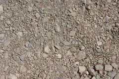 Picture of tamped gravel or crushed stone of various grain sizes. Picture of tamped gravel or crushed stone of various sizes and colors, predominantly greyish Stock Images