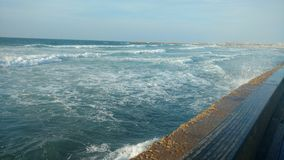 A picture from TEL AVIV PORT. Waves break in the north tel aviv port -  near Yarkon river Royalty Free Stock Image