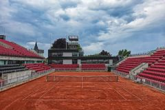 Picture of tennis court with red ground and beautiful cloudy sky Royalty Free Stock Image