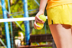 Picture of tennis player's hand, holding two balls Royalty Free Stock Images