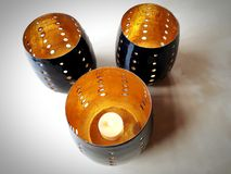 Home decoration - three candlelight holders royalty free stock photo
