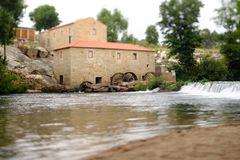 Tilt and shift mill-house. A picture with a Tilt and shift lens of a mill-house in Vilar de Mouros, Portugal royalty free stock image