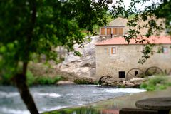 Tilt and shift mill-house. A picture with a Tilt and shift lens of a mill-house in Vilar de Mouros, Portugal stock photography