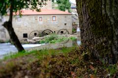 Tilt and shift mill-house. A picture with a Tilt and shift lens of a mill-house in Vilar de Mouros, Portugal royalty free stock photography