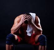 Picture of tired athletic man. Tired sportsman after hard training Stock Photo