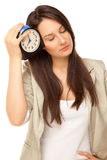 Picture of tired businesswoman with alarm-clock Royalty Free Stock Images
