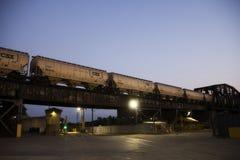 Train going over a bridge at night in Cincinnati Ohio stock photo