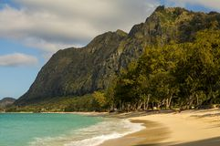 Waimanalo Beach Oahu Hawaii. This is a picture of the tropical Waimanalo Beach Oahu  Hawaii, with lush mountains and aqua blue water Stock Photo
