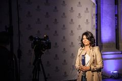 N1 TV anchor reporting from the city center of Belgrade at night. N1 is a cable news channel belonging to CNN located in balkans royalty free stock photo