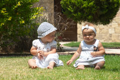 Picture of two baby child having fun playing outdoors, best friends, happy family, love and happiness concept Stock Photography