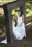 Picture of two brides under concrete object in nature surroundin Royalty Free Stock Photos