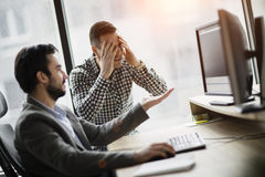 Picture of two businessmen having problems in office. Picture of two young businessmen having problems in office Royalty Free Stock Photo