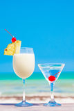 Picture of two cocktails on a table near beach Stock Photography