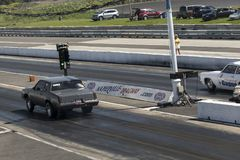 Drag car competitors on the track. Picture of two drag car competitors on the track making a start during the john scotti all out, august 20 2016 Stock Image
