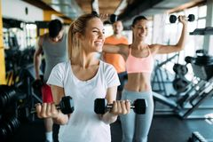 Picture of two fitness women in gym. Picture of two beautiful fitness women in gym stock images