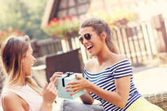 A picture of two girl friends making a surprise birthday present Royalty Free Stock Photography