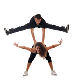 Picture of two modern dancers. Man jumping on the woman's back Stock Photos